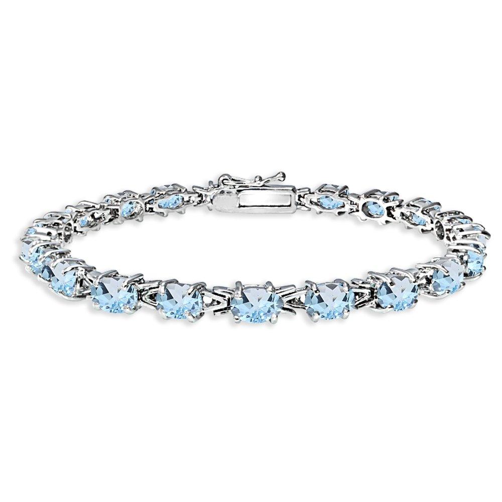 Sterling Silver Polished Blue Topaz 6x4mm Oval-cut Link Tennis Bracelet