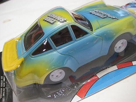 Amazon.com: Toy Kids Turbo Sparker Light Blue/Yellow Porsche 930 Plastic/Friction NIB: Toys & Games