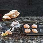 Bellemain 12-Cup Nonstick Madeleine Pan 8 Makes classic French shell-shaped madeleines Heavy-duty carbon steel Conducts heat quickly and evenly