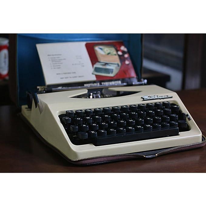 Máquina de escribir 8typewriter, Vintage años 80 Antigua Inglés con Carcasa de metal con bolsa de tela, para un uso Normal: Amazon.es: Hogar