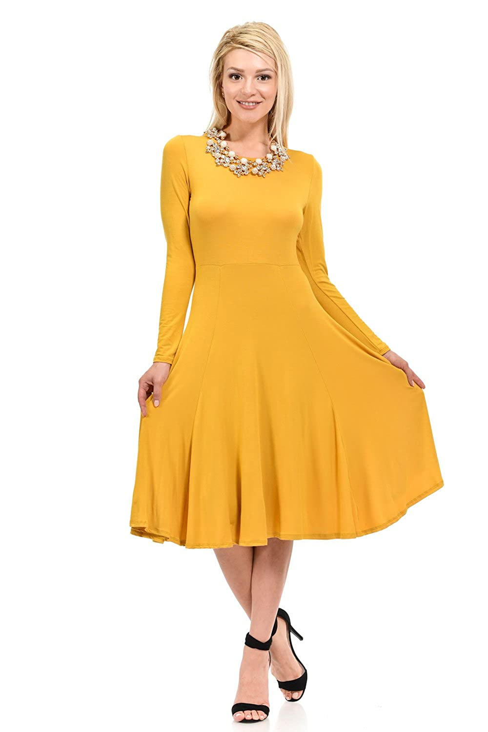 ac6ac36fd214 This elegant dress features full skirt, long sleeves, rounded neckline and  skater silhouette. It is made of soft jersey knit that has great stretch  and ...