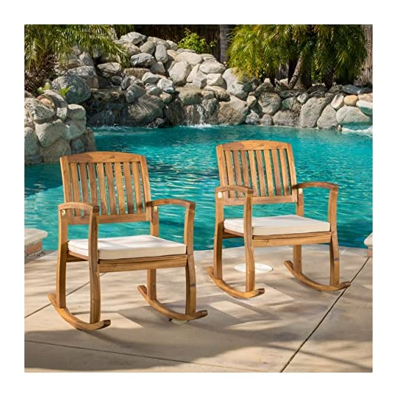 Sadie Outdoor Acacia Wood Rocking Chairs with Cushion (Set of 2) - Includes: two (2) Rocking Chair material: acacia wood cushion material: fabric finish: teak cushion color: White assembly required dimensions: 33.25 inches deep x 24.00 inches wide x 35.75 inches high seat width: 20.75 inches seat depth: 19.00 inches seat Height: 16.50 inches arm Height: 26.75 inches Brand name: Christopher Knight Home Made in China - patio-furniture, patio-chairs, patio - 61q1SGNoztL. SS570  -
