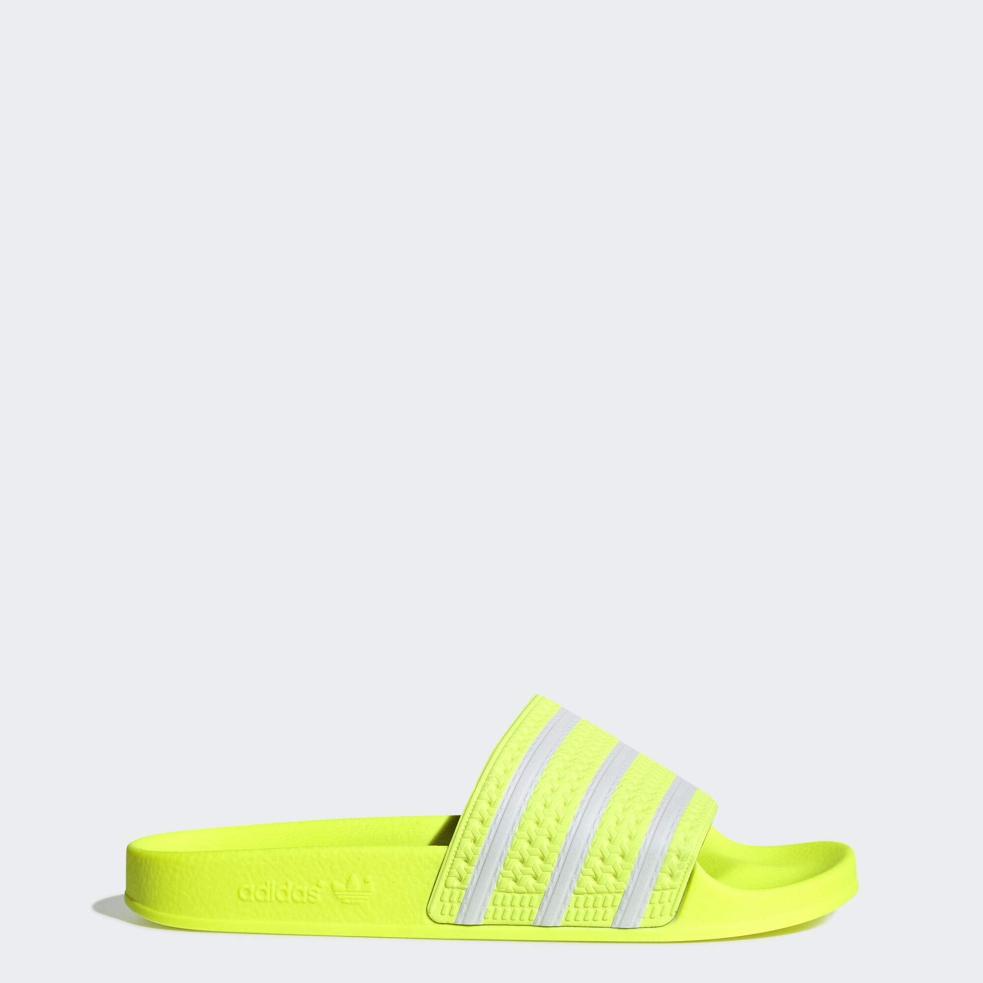 adidas Originals Men's Adilette Slide Sandal, White/Solar Yellow, 11 M US by adidas Originals