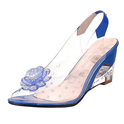 Sandalias transparentes con motivoz azules y flor tridimensional.