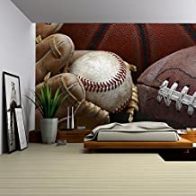 wall26 - Close Up Shot of Well Worn Baseball in Baseball Glove, Football and Basketball - Removable Wall Mural | Self-adhesive Large Wallpaper - 100x144 inches