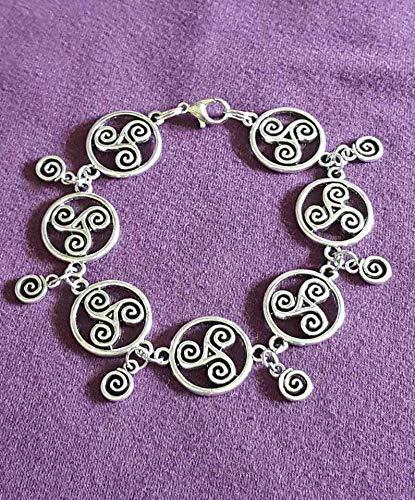 - Handmade Boho Celtic Spiral and Small Dangle Charm Antique Silver Charm Bracelet