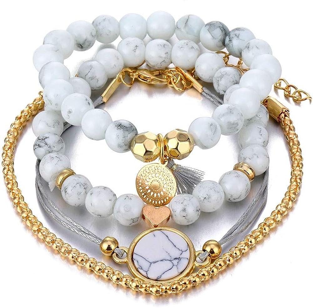 STRASS & PAILLETTES Set de 4 Pulseras de mármol Blanco Azulado. Pulsera de Perlas de Piedra y pequeño corazón Dorado. Pulsera rosetón y Pompon Gris Azulado. Pulsera de Bola de Oro