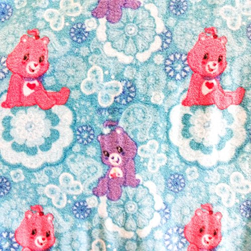 care-bears-flowers-on-blue-anti-pill-animal-theme-fleece-fabric-60-inches-wide-sold-by-the-yard-fb