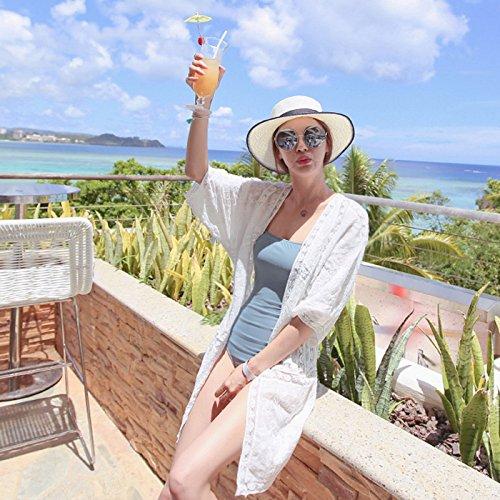 En la playa larga de encaje bordado de ropa de protección del ruido exterior delgado cardigan abrigo playa bikini. Blusa blanca