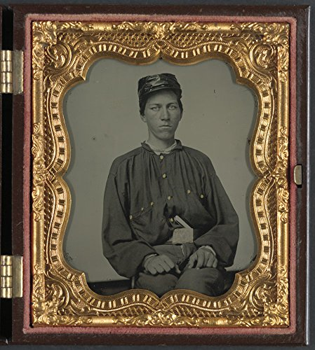 Unidentified soldier in Confederate uniform and Louisiana state seal belt buckle and oilcloth cover on kepi