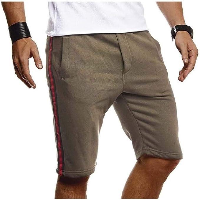 Candiyer 伸縮性のあるファブリックソリッドポケット100%コットンスポーツショートパンツを実行している男性