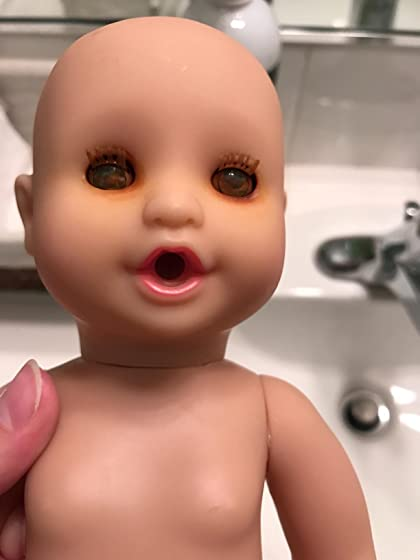 Melissa & Doug Annie Drink & Wet Doll Scary eyes...