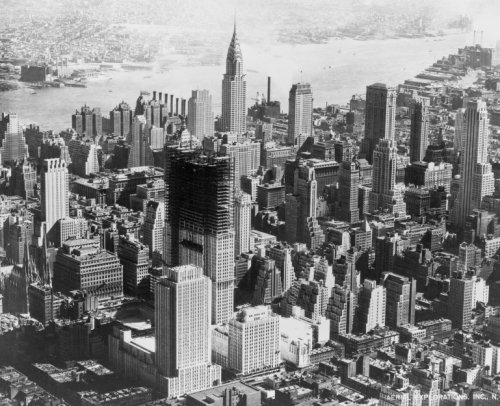 1932 photo Rockefeller Center rises in mid-Manhattan graphic / Aerial Explorations, Inc., N.Y. photograph shows aerial view of mid-town Manhattan during construction of Rockefeller Center. Vintage 8x10 Photograph - Ready ()