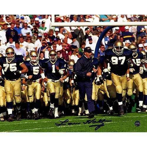 Lou Holtz Running On Field with Team Horizontal 8x10 Autographed Signed Photo - Authentic ()