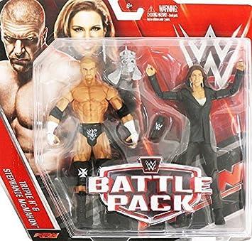 WWE Pack De Lucha Serie 42 Figuras De Acción - Calavera Rey Triple H & RAW General Gerente Stephanie Mcmahon w/ Micrófono y del cráneo Casco: Amazon.es: Juguetes y juegos