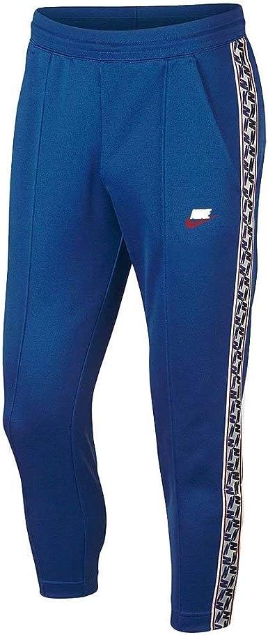 Mirar atrás burbuja loseta  Amazon.com: NIKE Sportswear Taped Poly Pants (2XL, Blue): Clothing