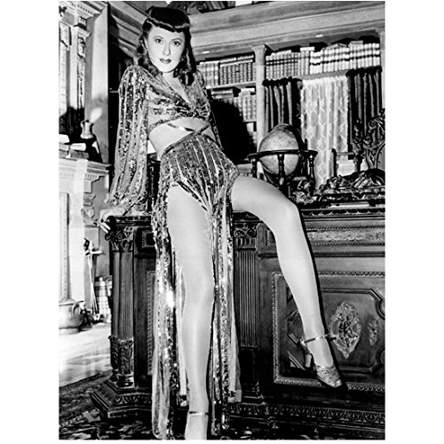Barbara Stanwyck Posing on Desk with Flapper Flare 8 x 10 Inch Photo