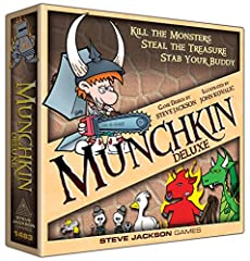 """Includes 168 cards, 6 standies, 6 player cards, gameboard, rules, and die. What makes this edition """"deluxe""""? It's got a big gameboard to keep your cards in place, and six colored standies that you move on the gameboard as you level up. Plus a..."""