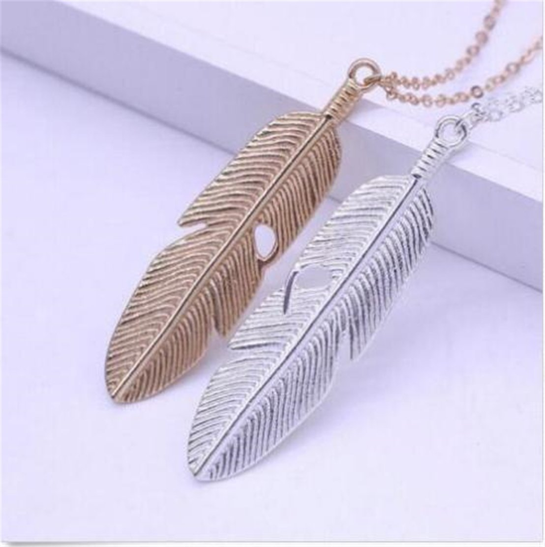 Feather Pendant Necklace $2.18...