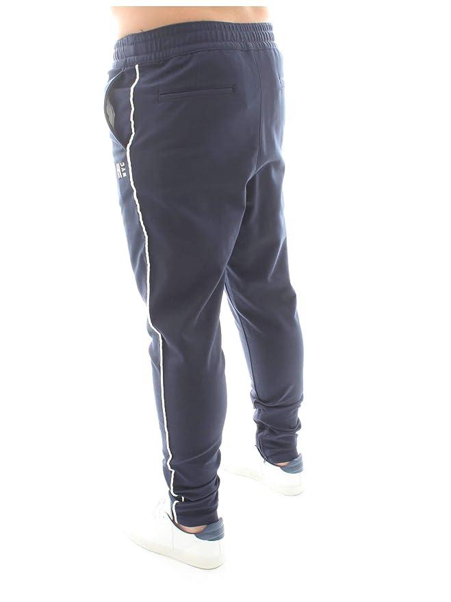 Tommy Hilfiger MW0MW09038 Pantalones de chándal Hombre M: Amazon ...