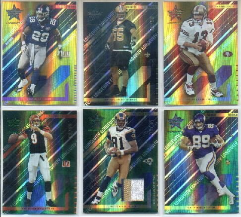 - 2004 Leaf Rookies and Stars Longevity Materials Emerald #84 Torry Holt Game-Worn Jersey Card Serial #'d/35