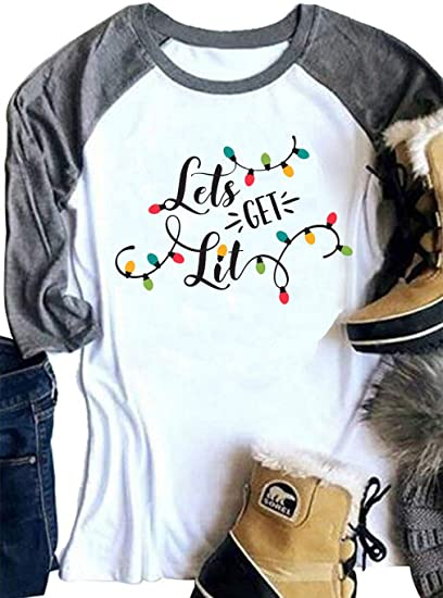 6f05fb8312ca2 VILOVE Women Let s Get Lit Merry Christmas Shirts Funny Holiday Christmas  Lights Tshirt Tops Blouse at Amazon Women s Clothing store