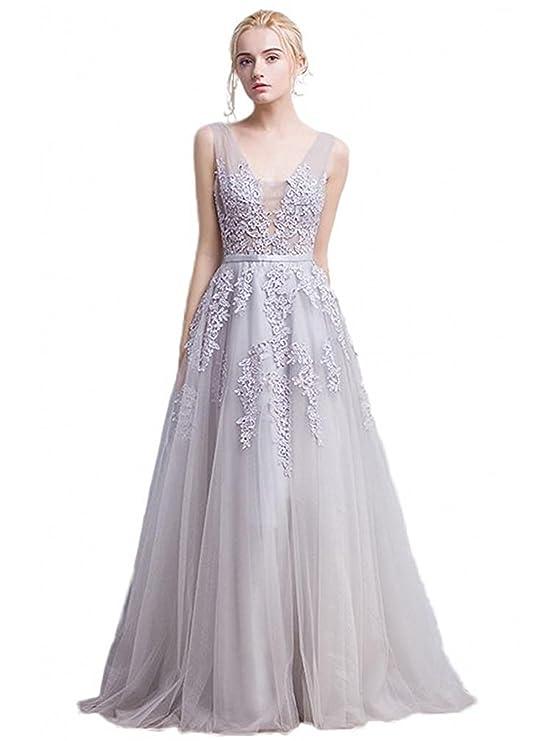 26edd5994 El vestido de novia de Babyonlinedress está hecho a mano en encaje y tul.  No presenta cola y viene con sujetador incorporado. La limpieza se hace en  seco.