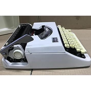 Máquina de escribir Vintage Inglés antiguo/Vintage francesa años 80 Portátil para uso Normal: Amazon.es: Hogar