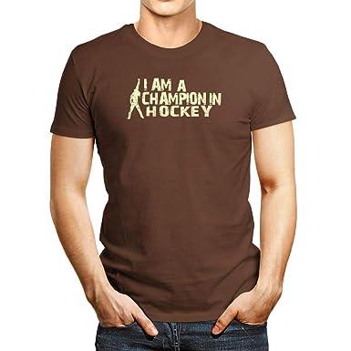 63cb566f6b4a Amazon.com: Idakoos I AM A Champion in Hockey T-Shirt Brown: Clothing
