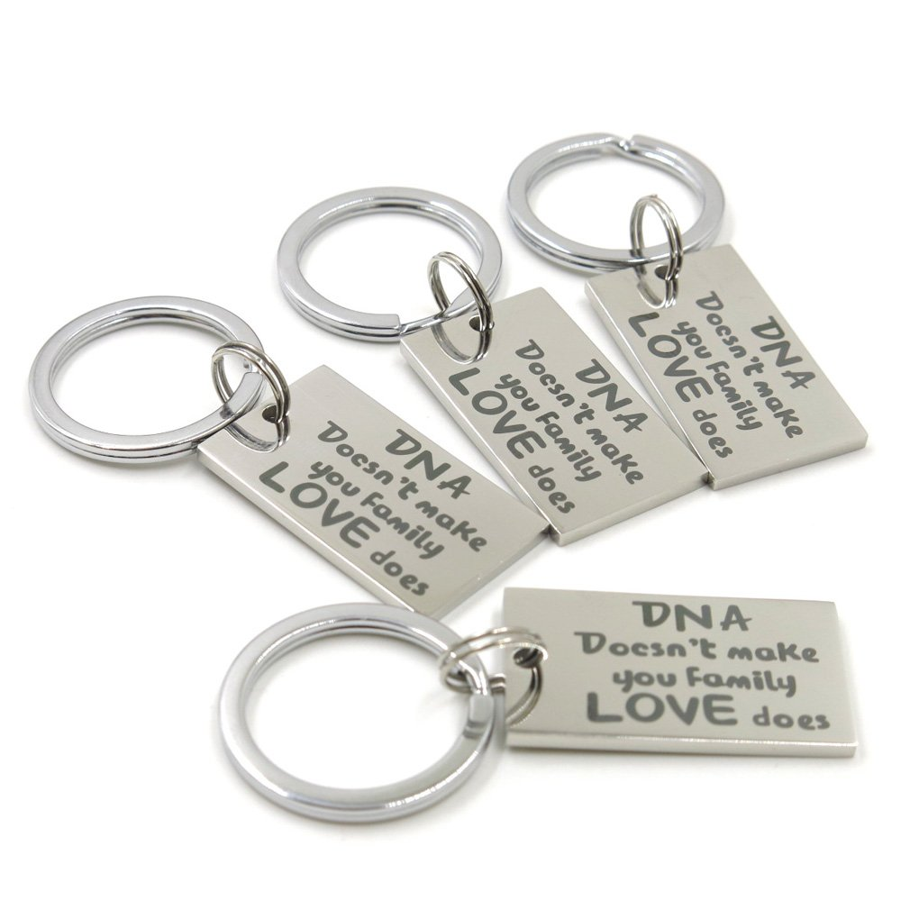 ''DNA Doesn't Make You Family,Love Does'' Keychain For Family.(4pieces)