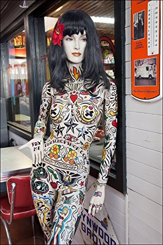 Photograph of an interesting and colorful naked woman mannequin full of colorful ink tattoos. Perfect gift for men, boyfriend, husband or man cave.