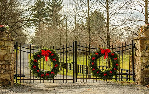 LAMINATED 38x24 inches Poster: Christmas Wreath Holiday Decorations Evergreen Wreath Red Bows Wrought Iron Gates Stone Pillars Estate Entrance Driveway Winter Fence Christmas Decorations