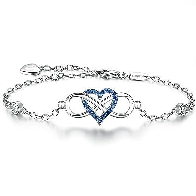 Bracelet infini pour femme avec cœur centré orné de pierre bleu ciel foncé