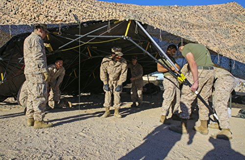 LAMINATED POSTER Marines set up the tents for the combat ope