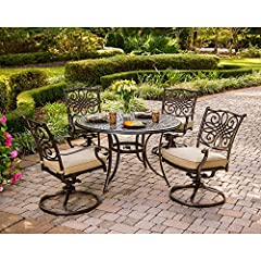 """The traditions 5Piece dining set beautifully transforms any backyard into an elegant outdoor dining area with its superior quality & deep comfort feel. Included in this set are four deep cushioned swivel chairs & a 48"""" Round dining ta..."""