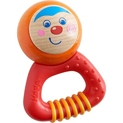 HABA Musical Character Mio - Rattle, Clutching Toy and Teether with Friendly Wooden Face and Plastic Teething Handle (Made in Germany): Toys & Games
