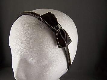 Amazon.com   Dark Brown side bow faux patent leather headband hair band grip  teeth   Beauty 01fd9b426ca