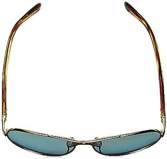 ec56fe665c5 Amazon.com  Oakley Women s Tie Breaker Sunglasses Gold Violet  Clothing