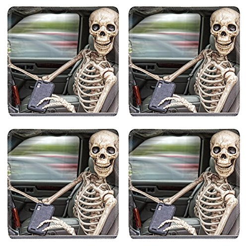 Liili Natural Rubber Square Coasters IMAGE ID: 23213200 A skeleton behind the wheel of an SUV distracted by his cell phone He is also not wearing a seatbelt