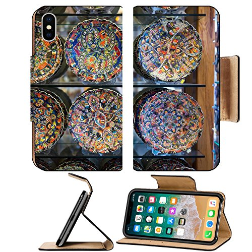 Luxlady Premium Apple iPhone X Flip Pu Leather Wallet Case IMAGE ID: 34253574 Collection of turkish traditional handpainted pottery plates in souvenir shop Shallow depth of