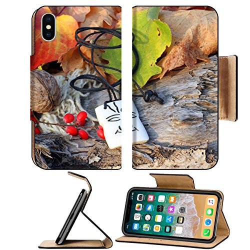 Luxlady Premium Apple iPhone X Flip Pu Leather Wallet Case IMAGE ID: 34628313 Ethnic handmade bone magic african amulet on autumn style background