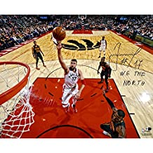 "Jonas Valanciunas Toronto Raptors Autographed 16"" x 20"" Floater Photograph with We The North Inscription - Fanatics Authentic Certified"