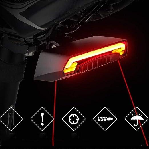 La luz posterior de la bicicleta con el control remoto de la señal ...