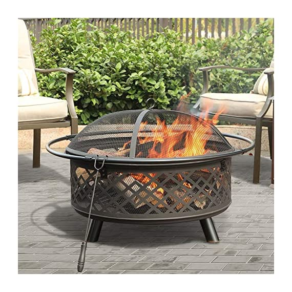 """PHI VILLA 32"""" Fire Pit Large Steel Patio Fireplace Cutouts Pattern with Poker & Spark Screen - ❤32"""" Fire Pit With Screen: Measures Dia.32"""" x H19.7"""". Approx 25 pounds. Lightweight and portable to move by catching the iron ring around ❤Spark Guard/Poker/Steel Net: Heavy-gauge spark screen protects you and your guests from sporadic flames and embers, offering an extra layer of safety. The poker helps you remove the spark screen and move logs more easily. Additional steel net is included to support the wood and let the air in beneath ❤Deep Steel Bowl: Large, deep-drawn steel bowl accommodates large fires for added warmth and convenience. Stable steel construction and heat-resistant painting keep the fire pit long lasting. Decorative lattice design cutouts for better flame visibility - patio, outdoor-decor, fire-pits-outdoor-fireplaces - 61tZVbEiZuL. SS570  -"""