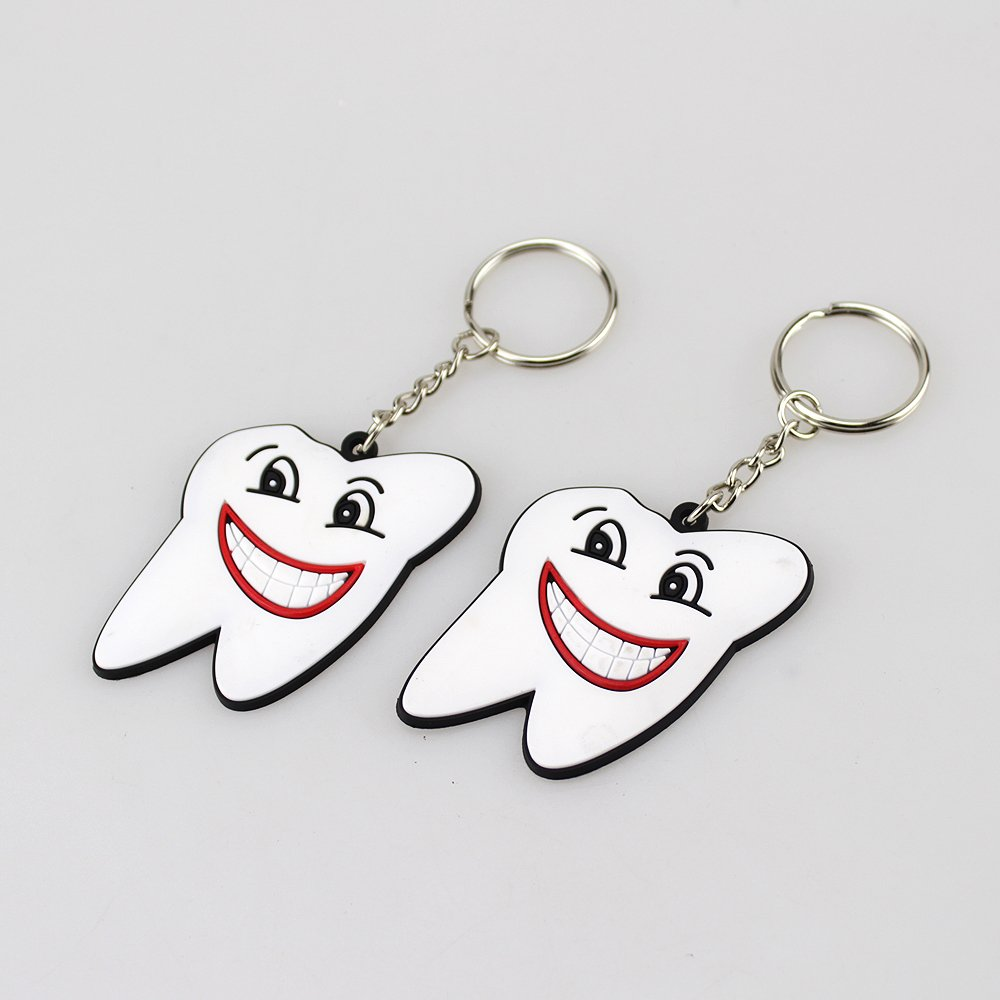 Airgoesin 100pcs Keychain Key Ring Hang Rubber Tooth Smile Shape Dental Clinic Gift Christmas Holiday Charms for Kids Birthday Party Favors & School Carnival Prizes