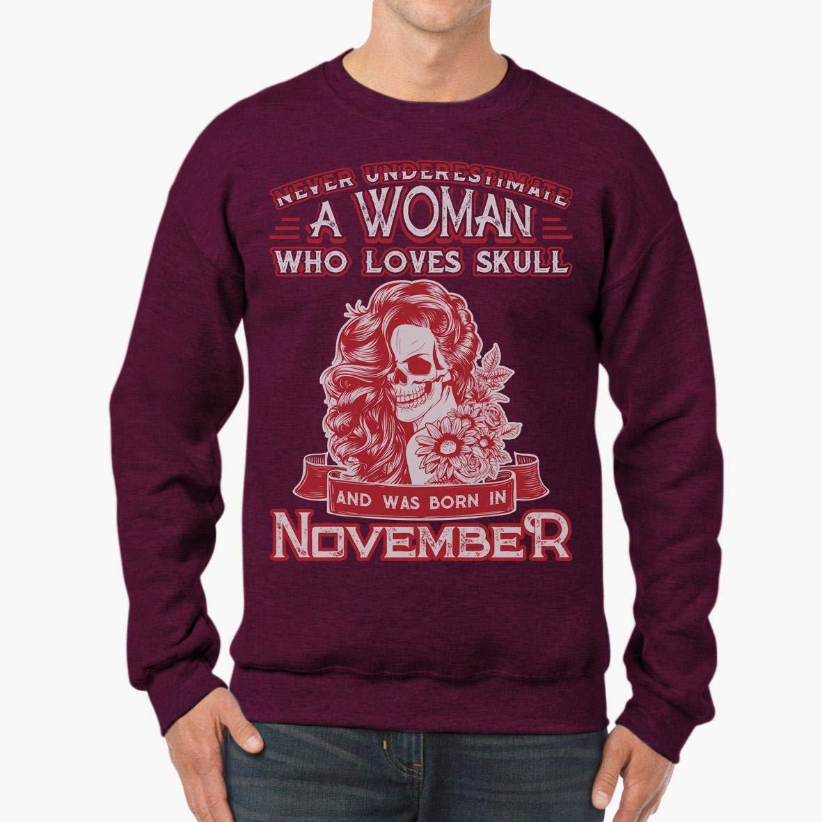 a Woman Loves Skull and was Born in November Unisex Sweatshirt tee