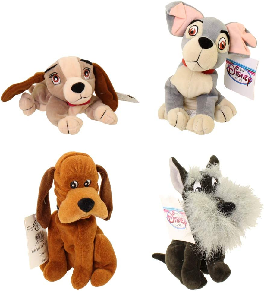 Amazon Com Retired Disney Lady And The Tramp Complete Set Of 4 Plush Bean Bag Dolls Including Tramp Lady Jock And Trusty Mint With Tags Toys Games