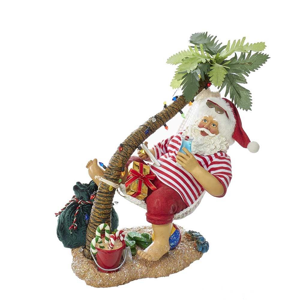 Kurt Adler C7468 10'' Fabriche Beach Santa on Hammock Under Palm Tree