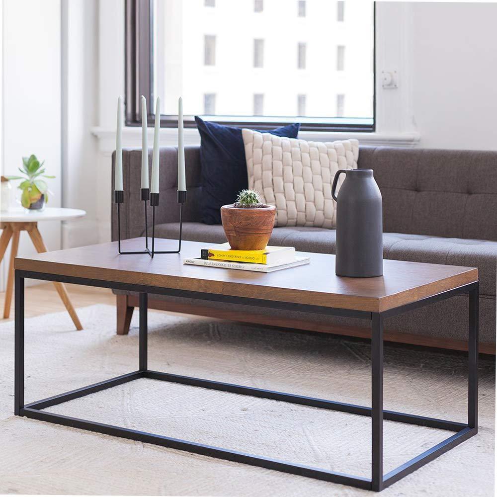 Amazon com nаthаn jаmеs home decor 31101 doxa solid wood modern industrial coffee table black metal box frame with dark walnut finish home kitchen