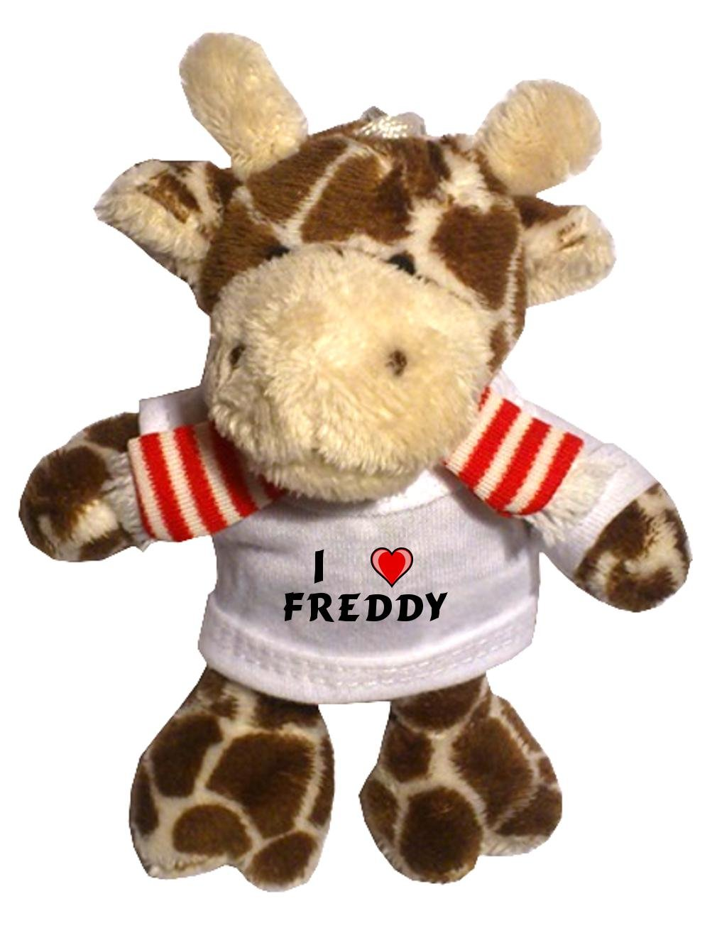 Jirafa de peluche (llavero) con Amo Freddy en la camiseta ...
